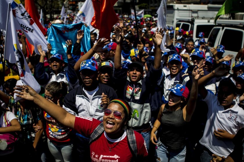 A group of people mobilize Wednesday to support the government of President Nicolas Maduro in Caracas, Venezuela.