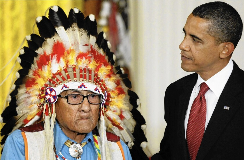 President Obama presents the 2009 Presidential Medal of Freedom to Joseph Medicine Crow, an acclaimed Native American historian who was the Crow Tribe's last surviving war chief.