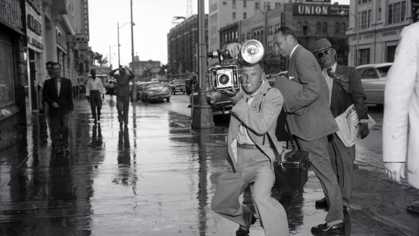 Photographer Ed Neil poses for a newspaper marketing photo in 1958. U-T FILE PHOTO User Upload Capt