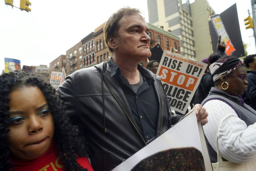 "FILE - In this Oct. 24, 2015 file photo, director Quentin Tarantino, center, participates in a rally to protest against police brutality in New York. Calls by police groups to boycott Quentin Tarantino's ""The Hateful Eight"" are putting pressure on one of December's most anticipated releases and ins"