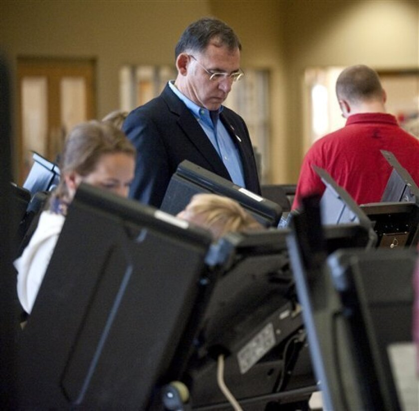 U.S. Rep. John Boozman, Republican candidate for U.S. Senate, casts his vote on Tuesday, Nov. 2, 2010, in Rogers, Ark. (AP Photo/Beth Hall)