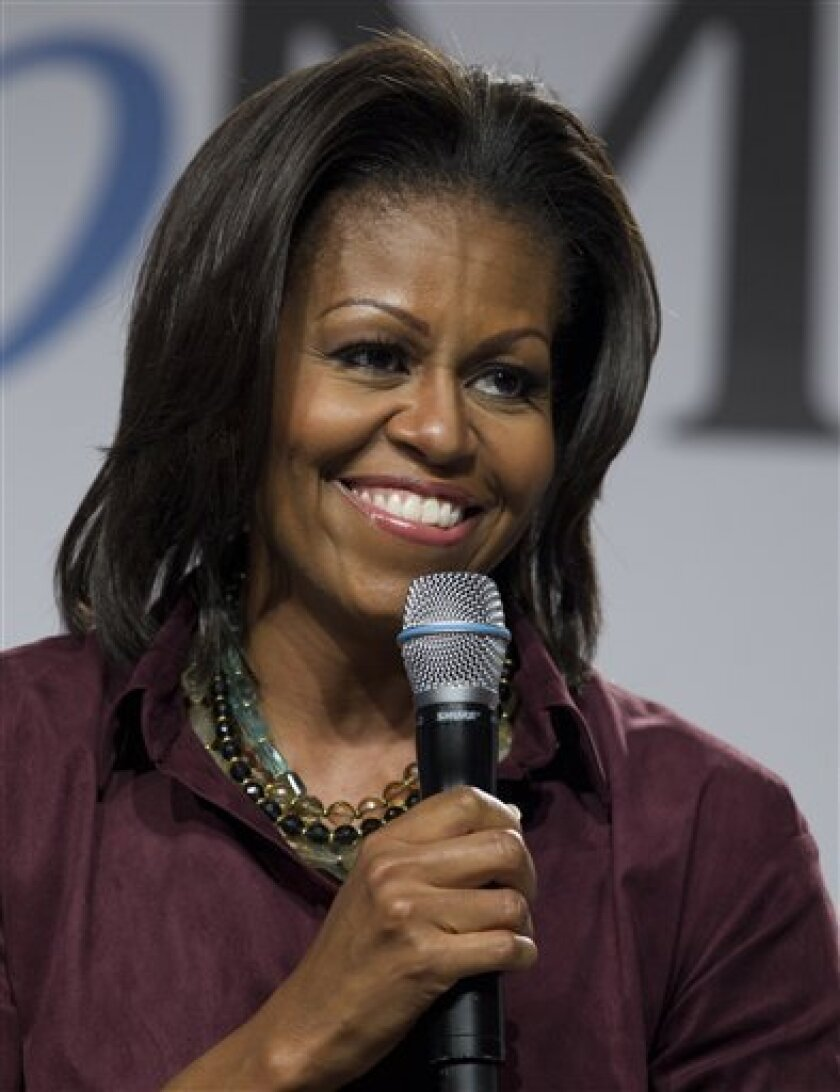 First lady Michelle Obama joins experts from WebMD for a town hall on healthy families at Homestead YMCA Family Center, Friday, Feb. 10, 2012, in Homestead, Fla., during her three day national tour celebrating the second anniversary of Let's Move. (AP Photo/Carolyn Kaster)