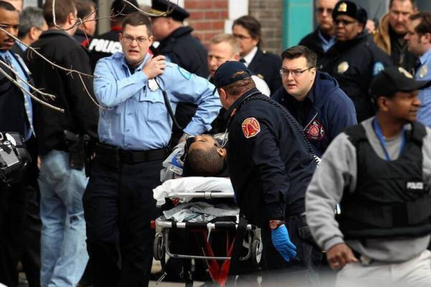 Emergency personnel respond to a shooting Tuesday at Stevens Institute of Business and Arts in St. Louis. A gunman shot a school official and himself, leaving both wounded, authorities said.