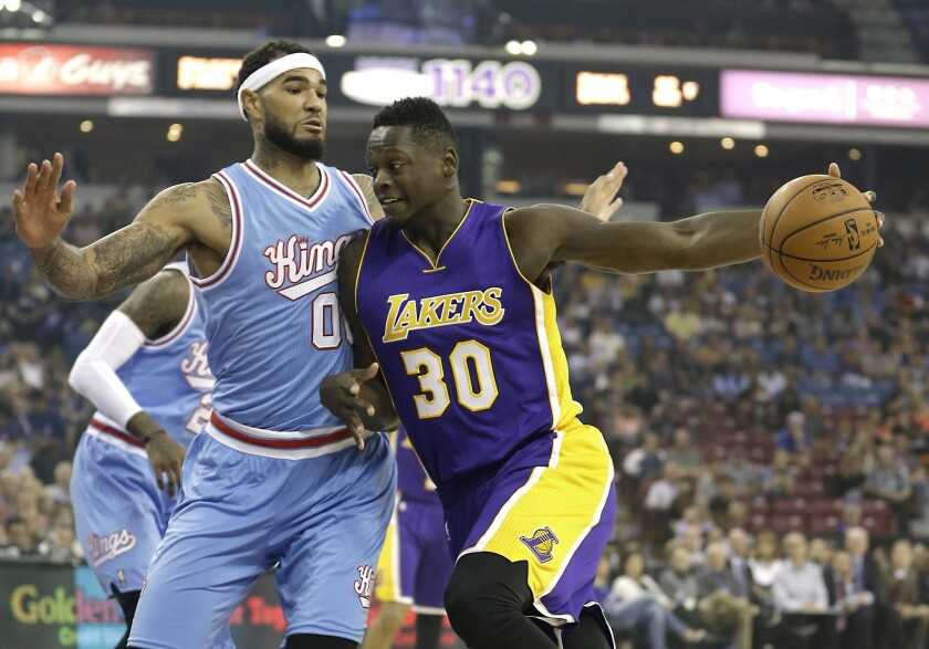 Sacramento Kings center Willie Cauley-Stein, left, stops the drive of Los Angeles Lakers forward Julius Randle during the first quarter on Friday.