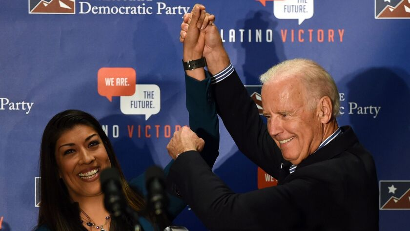 Then-Democratic candidate for lieutenant governor and Nevada Assemblywoman Lucy Flores introduces U.S. Vice President Joe Biden at Las Vegas rally in 2014.. Flores wrote that she felt demeaned and disrespected when Biden touched her offstage.