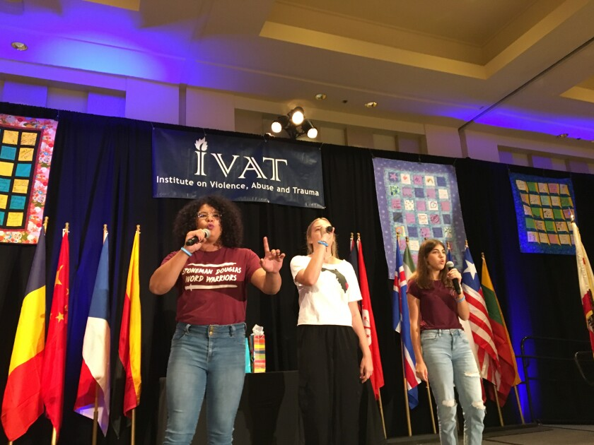 Students Marisol Garrido, Payton Francis and Sofia Rothenberg, survivors of the deadly school shooting in Parkland Florida, perform songs about their experience at the 24th International San Diego Summit on Violence, Abuse and Trauma across the Lifespan Sunday.