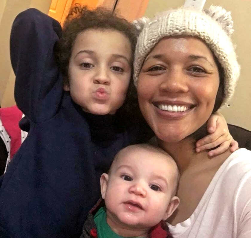This January 2019 selfie photo released by Cydnee Rafferty shows herself and her two children, Devin