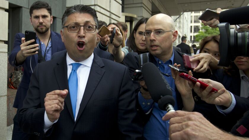 Assistant Atty. Gen. Makan Delrahim, who tried unsuccessfully to block the AT&T-Time Warner merger, speaks to reporters as he leaves the federal courthouse Tuesday following a judge's ruling against the Department of Justice.