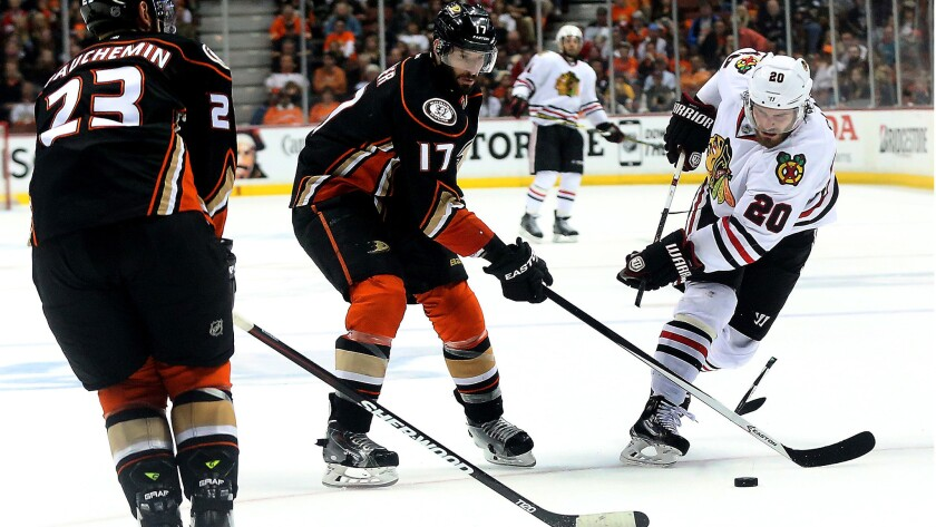 Ducks center Ryan Kesler is called for slashing as he shatters the stick of Blackhawks winger Brandon Saad in the second period of Game 7.