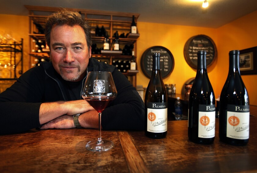 Steve Clifton, winemaker and owner of Palmina Vineyards, in his Lompoc tasting room with his 2007 Nebbiolo wines. He produces a full range of wines crafted from Italian varietals grown in Santa Barbara County.