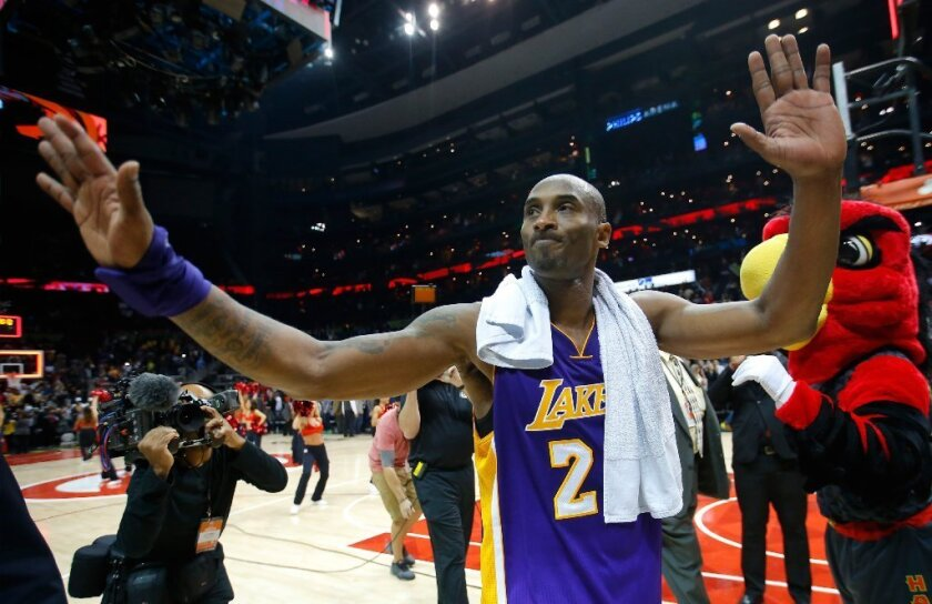 Kobe Bryant gestures to fans after the Lakers' 100-87 loss to the Atlanta Hawks on Dec. 4.