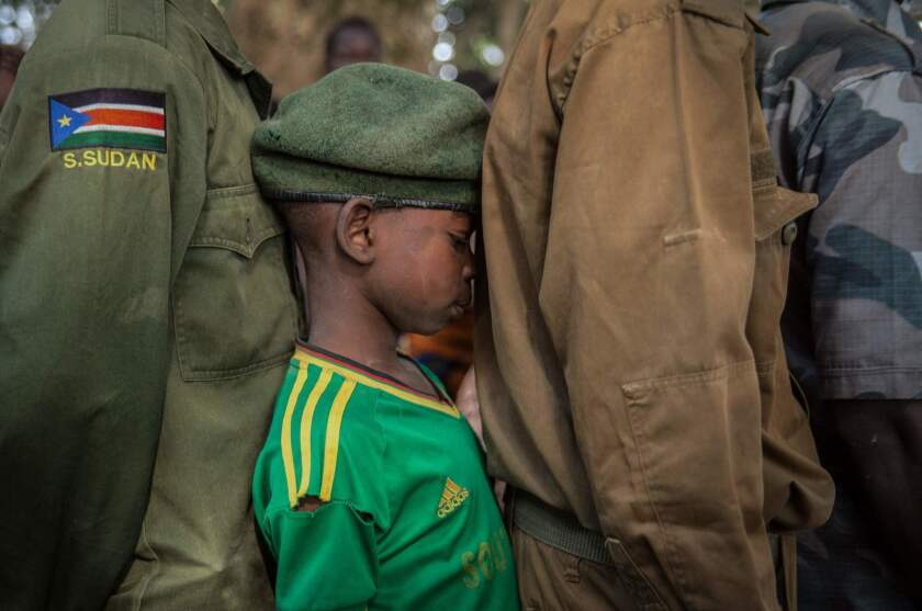 Newly released child soldiers wait in a line for their registration during the release ceremony in Yambio, South Sudan.