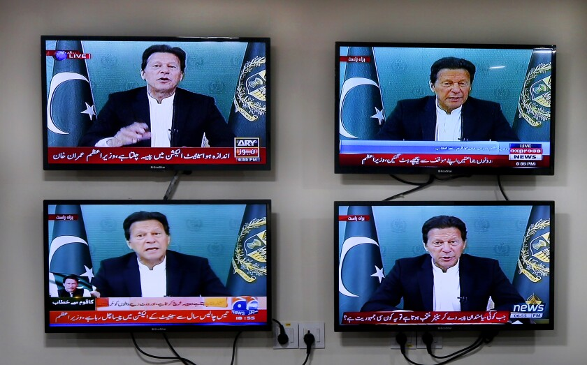 Various Pakistani news channels broadcast a live address to the nation by Pakistan's Prime Minister Imran Khan, at the office of The Associated Press, in Islamabad, Pakistan Thursday, March 4, 2021. Khan on Thursday announced he would seek a vote of confidence from the National Assembly this weekend to prove he still has the support of majority lawmakers in the house, despite the surprising and embarrassing defeat of his ruling party's key candidate in Senate's elections. (AP Photo/Anjum Naveed)
