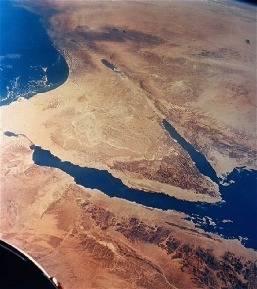 FILE - This undated file photo released by NASA, taken from 175 miles up by Gemini II, shows the Sinai Peninsula, center, in Egypt. Armed Bedouin tribesmen briefly abducted a Hungarian member of the multinational observer force in Sinai, releasing him around two hours later after tribal elders intervened, a security official said Thursday, Thursday, April 11, 2013. (AP Photo/NASA, File)