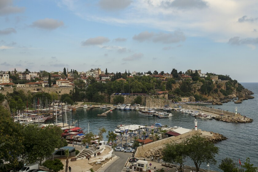 A general view of the old harbour, in Antalya, southern Turkey, Monday, June 21, 2021. Hotels in Turkey's Antalya region, a destination beloved by holidaymakers, are preparing to finally resume operations as they expect the return of international tourists after months of setbacks caused by the pandemic that halted travel. (AP Photo/Emrah Gurel)