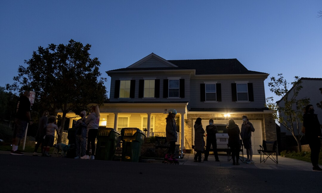 As dusk falls on Haijun Si's home, neighbors gather in front to form a nightly security detail