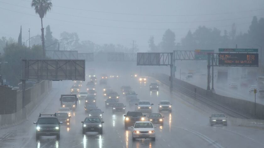 Commuters drive in the rain in Los Angeles on Wednesday.