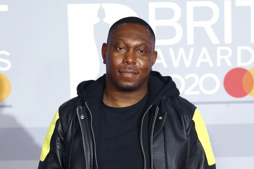 FILE - In this Tuesday, Feb. 18, 2020 file photo, Dizzee Rascal poses for photographers upon arrival at the Brit Awards 2020 in London. The Metropolitan Police said late Monday Aug. 2, 2021, rapper Dizzee Rascal was charged with assault after an incident in London that left a woman with minor injuries. (Photo by Joel C Ryan/Invision/AP, File)