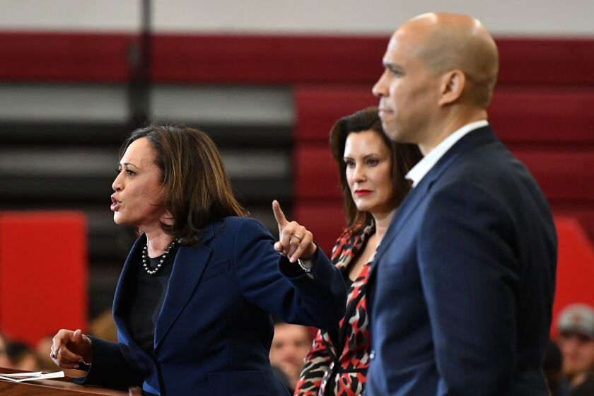 California Sen. Kamala Harris, left, speaks as New Jersey Sen. Cory Booker, right, and Michigan Gov. Gretchen Whitmer listen during a Joe Biden campaign rally at Renaissance High School in Detroit. Harris and Whitmer have been floated as potential vice presidential picks for Biden.