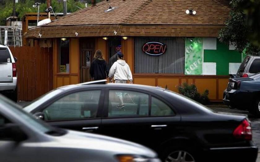 Customers enter a medical marijuana dispensary in the 9800 block of Magnolia Avenue in Riverside. Since 2009 the city has shut down 56 cannabis operators.