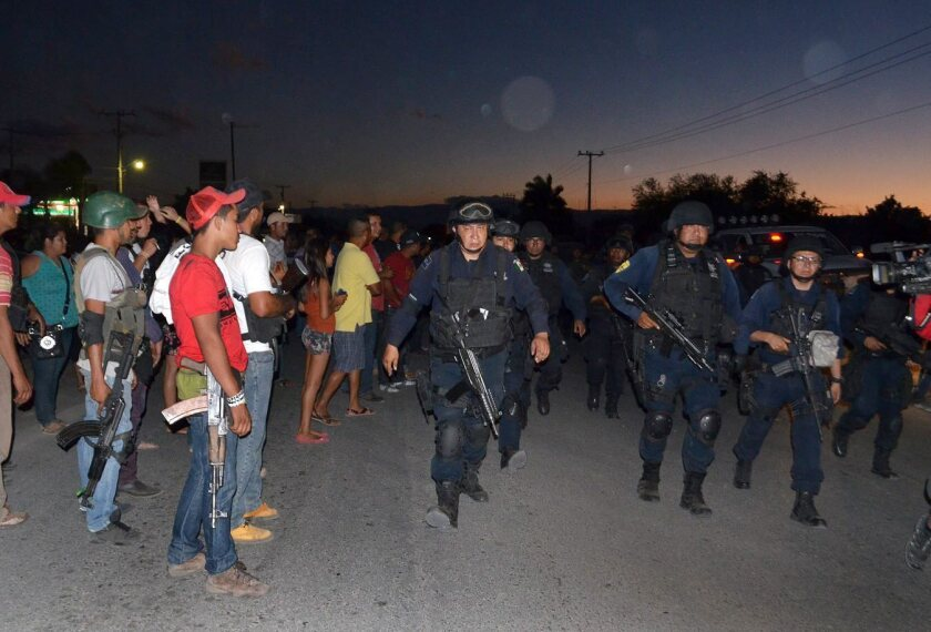 Self-defense groups eye Mexican security forces in Michoacan