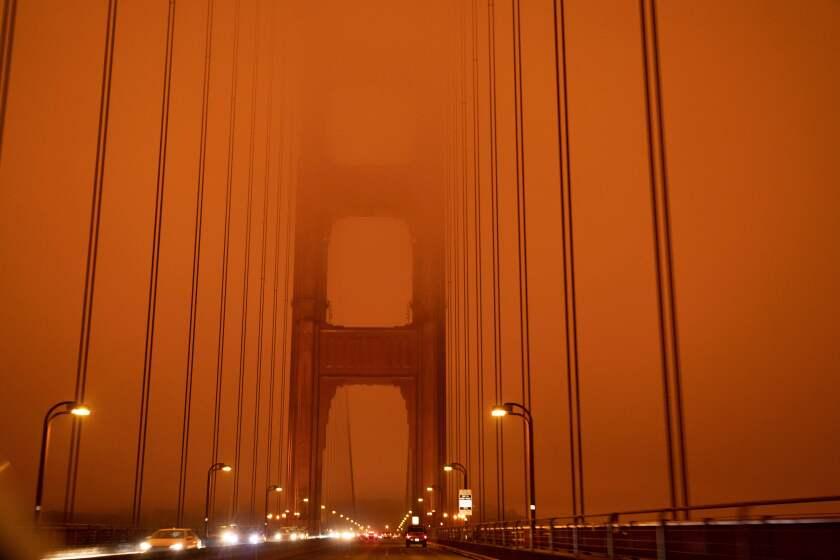 Orange smoke clouds the Golden Gate Bridge