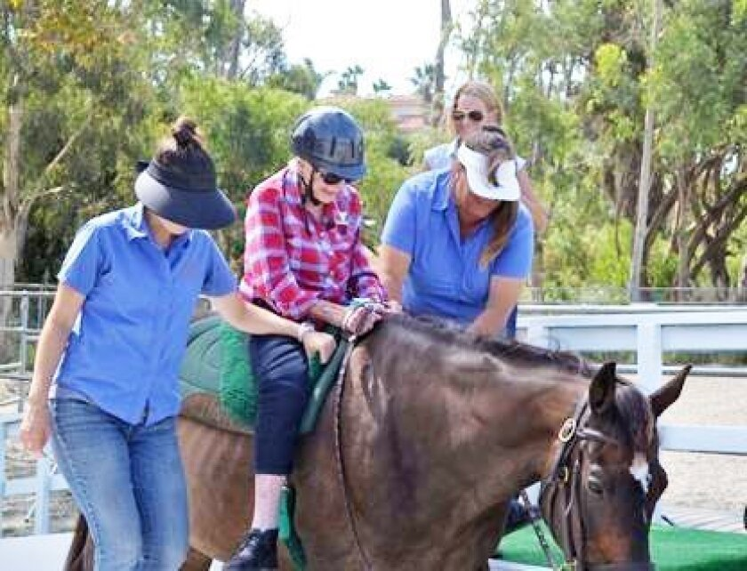 "Riding a horse again topped La Costa Glen resident Helen Downey's ""bucket list,"" and the Helen Woodward Animal Center helped make it come true. Courtesy photo"