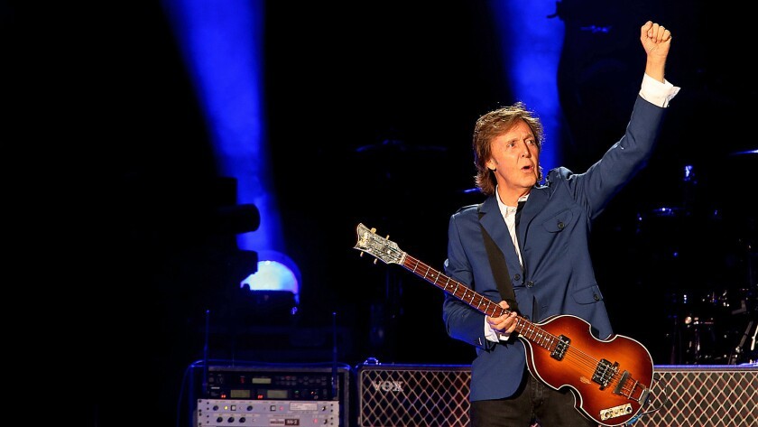 Paul McCartney greets the sold-out Dodger Stadium crowd before performing in Los Angeles Aug. 10.