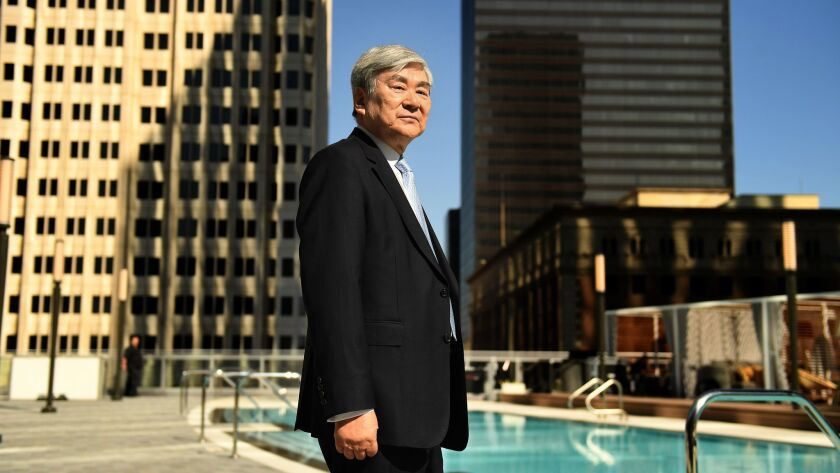LOS ANGELES, CALIFORNIA JUNE 22, 2017-Yang-Ho Cho, the man behind L.A.'s tallest building, stands ne