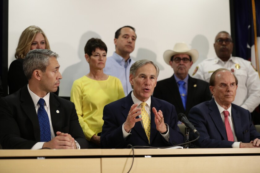 Texas Gov. Greg Abbott, center, says his state's size makes a stay-at-home order unnecessary.