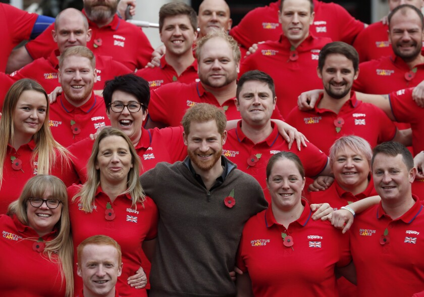Britain's Prince Harry poses for a photo during the launch of the team selected to represent the UK at the Invictus Games The Hague 2020, in London, Tuesday, Oct. 29, 2019. (AP Photo/Frank Augstein)
