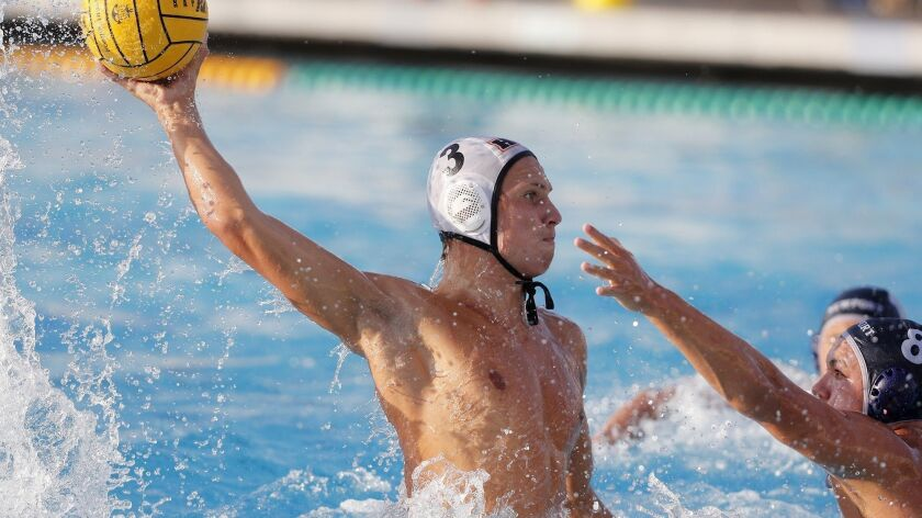Huntington Beach High's Jack Green (3) scores one of his two goals while Newport Harbor's Reed Stemler (8) defends during the first half of a Surf League match on Wednesday.