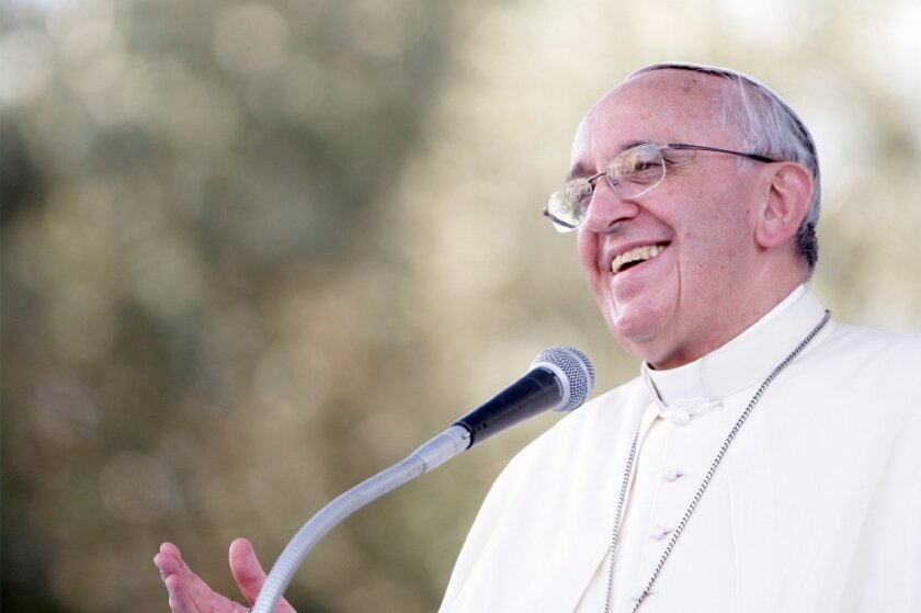 Liberals praised Pope Francis for his recent remarks on gay marriage, abortion and contraception -- but did they interpret his words correctly? Above, the pope delivers a speech in Italy earlier this month.