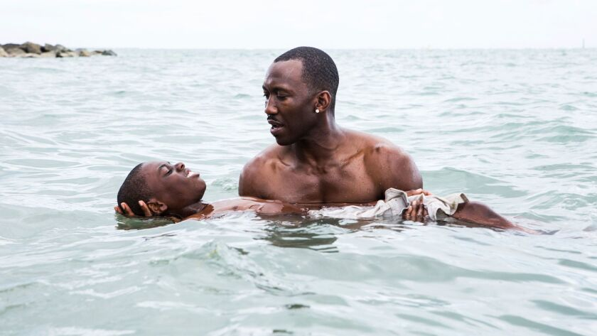 "This image released by A24 Films shows Alex Hibbert, left, and Mahershala Ali in a scene from the film, ""Moonlight."""
