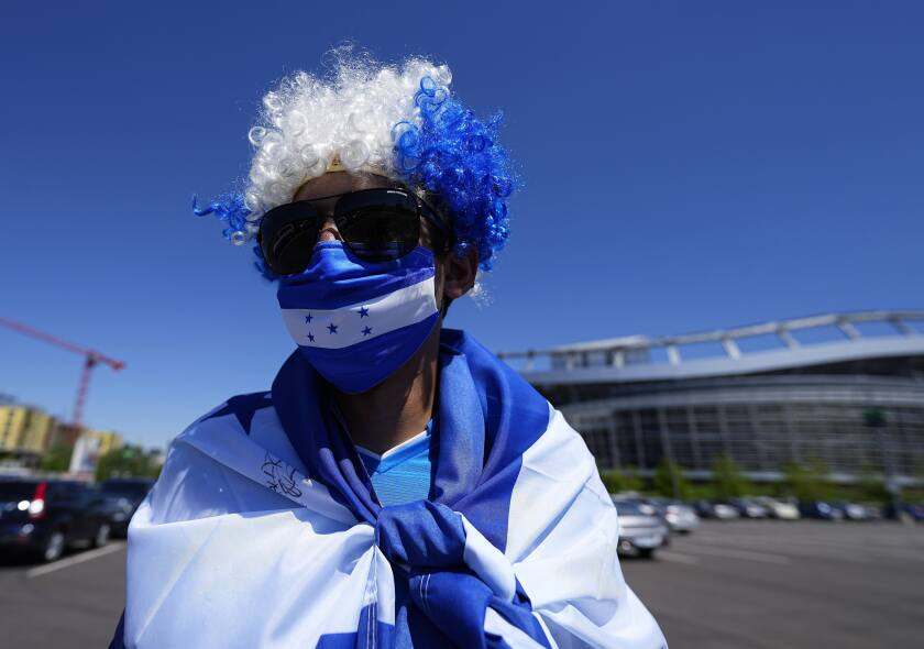 A Honduras soccer fan shows his support for the team before a CONCACAF Nations League semifinal soccer match against the United States, Thursday, June 3, 2021, in Denver. (AP Photo/Jack Dempsey)