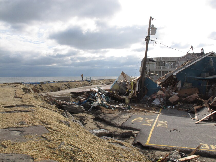 This Nov. 15, 2012 photo shows the remnants of an oceanfront building in Sea Bright N.J. that was destroyed by Superstorm Sandy. On Thursday, Oct. 15, 2020, New Jersey officials released a report committing the state to try to reduce its greenhouse gas emissions by 80% by the year 2050 to help fight climate change and rising sea levels. (AP Photo/Wayne Parry)