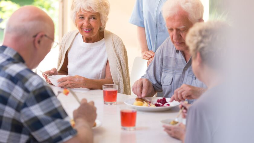 Pensioners eating lunch