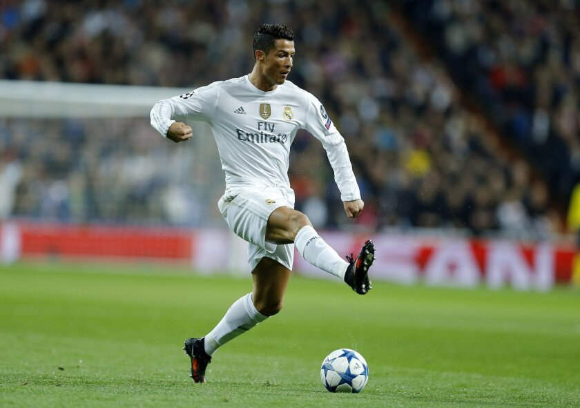 Real Madrid's Cristiano Ronaldo controls the ball during the Champions League group A soccer match between Real Madrid and PSG at the Santiago Bernabeu stadium in Madrid, Tuesday, Nov. 3, 2015. (AP Photo/Francisco Seco)