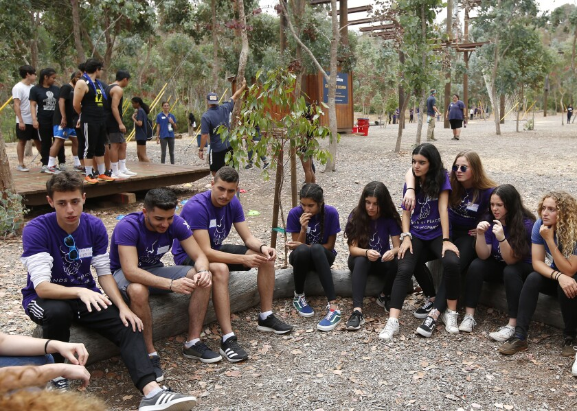 Israeli, Palestinian and American teens prepare for a team-building event on the high-wire Challenge Course at UC San Diego on Sunday during the annual three-week Hands of Peace summit. The Carlsbad program brings the next generation of leaders together for often-contentious dialogues and reconciliation on the political and religious issues that divide them.