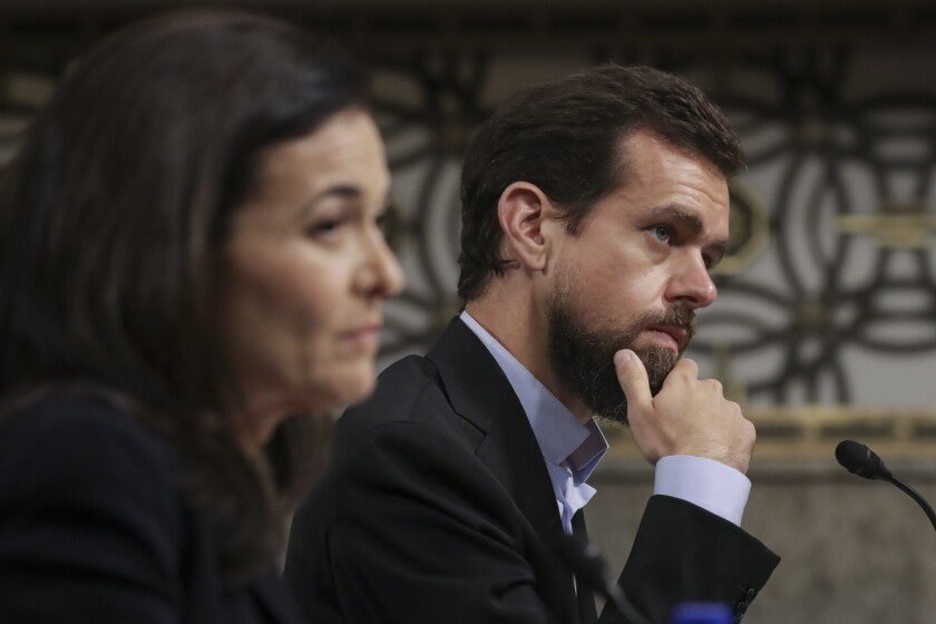 Facebook Chief Operating Officer Sheryl Sandberg and Twitter Chief Executive Jack Dorsey testify on Capitol Hill on Wednesday.