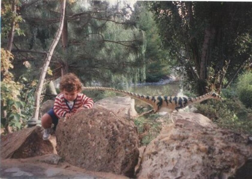 This photo released by Julee Morrison shows her then 18 month-old son Zac climbing over a rock wall at a dinosaur exhibit at the Museum of Natural History. Zac was mesmerized by dinosaurs and when his mom bent down to tie his older brothers shoe, he took the opportunity to go try to touch the dinosaur.