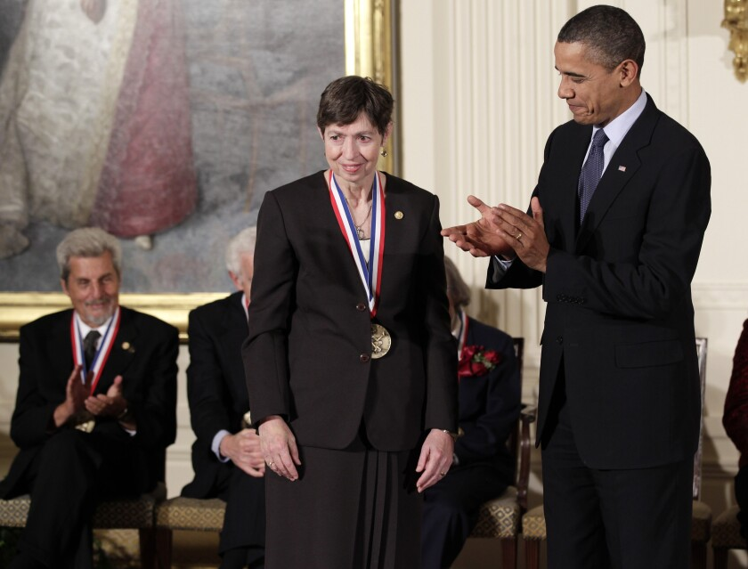 President Barack Obama stands with Marye Anne Fox