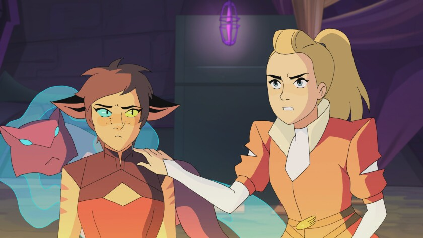 She-Ra and the Princesses of Power (2018–). Catra and Adora stand side by side in a dimly lit room with an eerie purple glow. Catra, a small cat-like girl with pointed ears and stripes on her arms, looks worried. Adora, a taller blonde girl with a high ponytail and human features, has her hand on Catra's shoulder protectively.
