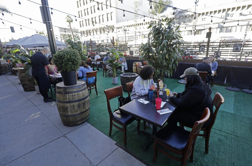 Visitors to Old Pasadena dine outdoors along Colorado Boulevard