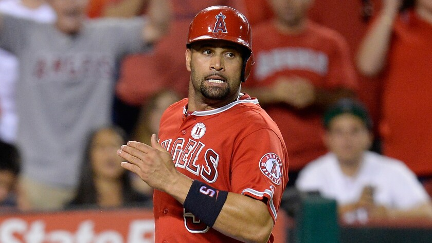 Angels' Albert Pujols exited the Angels' loss on Thursday night with left hamstring tightness.