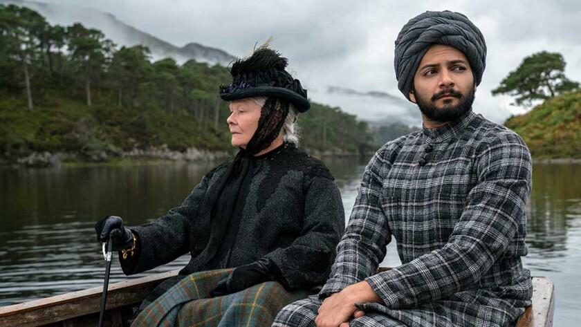 Judi Dench (left) stars as Queen Victoria and Ali Fazal (right) stars as Abdul Karim in director Ste