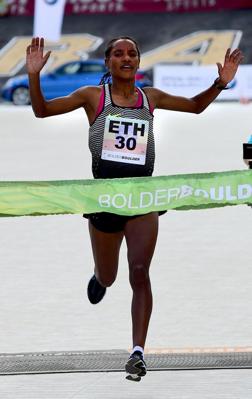 Amane Gobena, of Ethiopia, wins the pro women's race of the Bolder Boulder 10-kilometer (6.2-mile) run in Boulder, Colo., Monday, May 30, 2016. (Cliff Grassmick/Daily Camera via AP) MANDATORY CREDIT