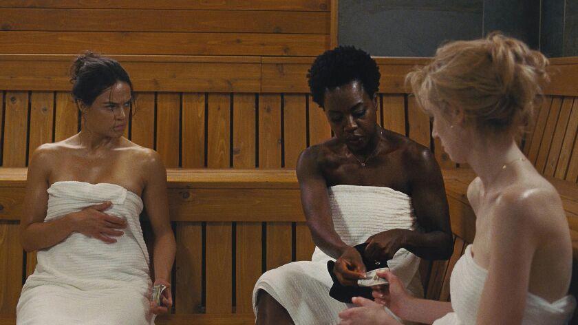 "From left to right, Michelle Rodriguez, Viola Davis, and Elizabeth Debicki star in ""Widows."""