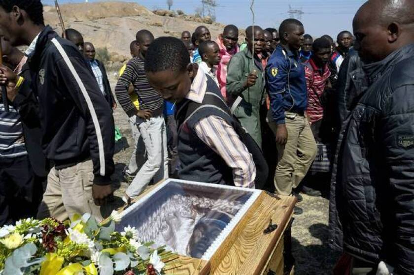 Outcry in South Africa as striking miners charged with murder