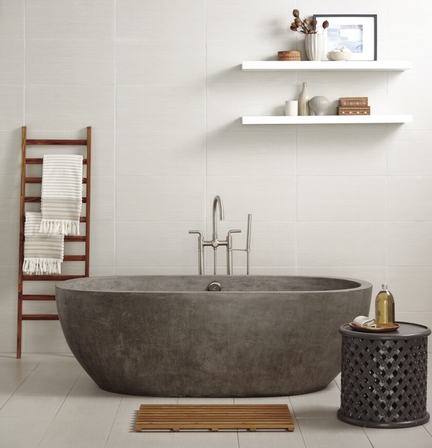 This Avalon 72-inch concrete free-standing tub by NativeTrails.com ($8,990) is hand-formed and polished, with thick walls to keep the soaking water warm longer.